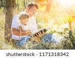 happy parent reading with child ... | Shutterstock . vector #1171318342