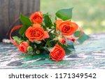 orange roses on a vintage... | Shutterstock . vector #1171349542