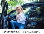 european woman sitting in car ... | Shutterstock . vector #1171363048