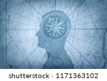 Small photo of Human head and compass. The concept on the topic of navigation, psychology, morality, etc.