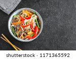 stir fry with udon noodles ... | Shutterstock . vector #1171365592