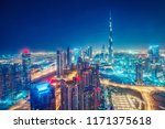 colourful nightime skyline of a ... | Shutterstock . vector #1171375618