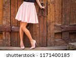 Girl wearing nude colored skirt ...