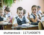 portrait of a group of primary... | Shutterstock . vector #1171400875