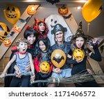 family in costumes has fun in... | Shutterstock . vector #1171406572