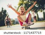 little girl on skateboard .... | Shutterstock . vector #1171437715