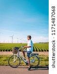 young man electric green bike... | Shutterstock . vector #1171487068