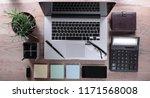 top view.work desk in modern... | Shutterstock . vector #1171568008