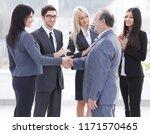 business handshake and business ... | Shutterstock . vector #1171570465