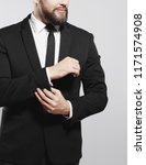 serious businessman adjusting...   Shutterstock . vector #1171574908