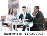 young businessman sitting... | Shutterstock . vector #1171577008