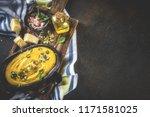 pumpkin parmesan soup wit... | Shutterstock . vector #1171581025