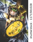 pumpkin parmesan soup wit... | Shutterstock . vector #1171581028