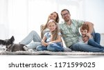 cheerful family sitting on the... | Shutterstock . vector #1171599025