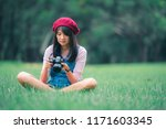 asian woman hold camera in... | Shutterstock . vector #1171603345