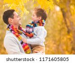 a little boy in the arms of his ...   Shutterstock . vector #1171605805