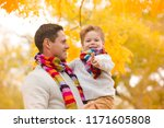 a little boy in the arms of his ... | Shutterstock . vector #1171605808
