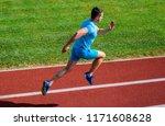 athlete run track grass...   Shutterstock . vector #1171608628