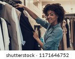 smiling young woman shopping in ... | Shutterstock . vector #1171646752