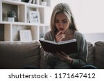 young beautiful woman reading...   Shutterstock . vector #1171647412