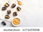 dates with peanut butter... | Shutterstock . vector #1171655038