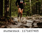 athlete runner with dirty legs... | Shutterstock . vector #1171657405
