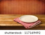 empty white plate on wooden... | Shutterstock . vector #117169492