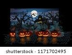 halloween theme with lit... | Shutterstock .eps vector #1171702495