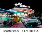 ORLANDO, FLORIDA, USA - DECEMBER, 2017: Beautiful Night at Mel's Drive-In restaurant with vintage classic cars at Universal Studios Florida - stock photo