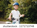 young boy in helmet riding... | Shutterstock . vector #1171713748