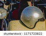 helmet on the hood of a dune...   Shutterstock . vector #1171723822