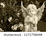 angel made of clay sitting on a ... | Shutterstock . vector #1171758448