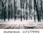 coffee on a winter backgrounds | Shutterstock . vector #1171779592
