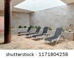 empty four gray lounge chairs... | Shutterstock . vector #1171804258