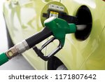 car refueling on a petrol... | Shutterstock . vector #1171807642