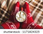 women's feet in red knitted... | Shutterstock . vector #1171824325