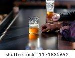 enjoying a craft beer at a brew ... | Shutterstock . vector #1171835692