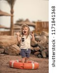 small kid laughing in orange...   Shutterstock . vector #1171841368