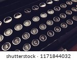 Small photo of Close up of vintage typewriter machine keys on writers desk, conceptual image for blogging, publishing, journalism or poetry writing.
