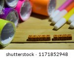 Small photo of Never stop on wooden cubes with colorful paper and pen, Concept Inspiration on wooden background