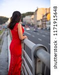 girl in a long red dress is... | Shutterstock . vector #1171915648