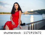 a girl in a long red dress is... | Shutterstock . vector #1171915672