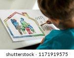 child colouring in a sketch of... | Shutterstock . vector #1171919575