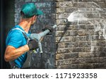 House brick wall washing using...
