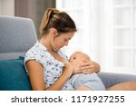 young mother  sitting at home... | Shutterstock . vector #1171927255