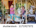 children going on merry go... | Shutterstock . vector #1171927372