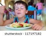 Cute Little Boy Enjoying Food