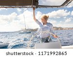 attractive blond female skipper ... | Shutterstock . vector #1171992865