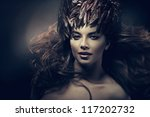attractive woman with long hair and feather hat - stock photo