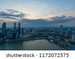 singapore cityscape at dusk.... | Shutterstock . vector #1172072575